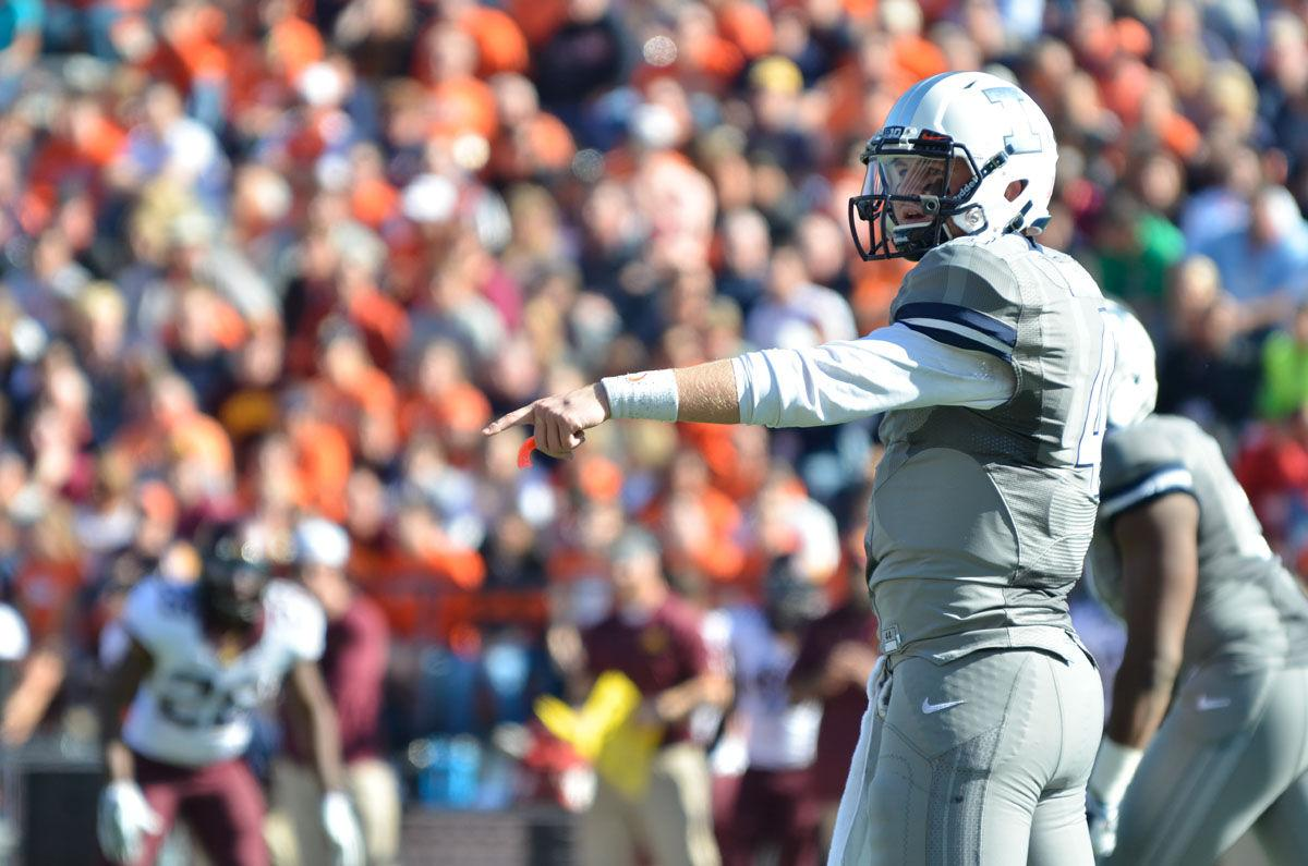 Illinois' Reilly O'Toole calls out a play during the homecoming game against Minnesota at Memorial Stadium on Saturday, Oct. 25, 2014. The Illini won 28-24.