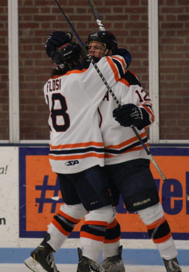 Illinois%E2%80%99+Matthew+Flosi+%2818%29+and+Jonathan+Langan+%2812%29+celebrate+after+Langan+scored+a+point+during+the+Ohio+hockey+game+at+the+Ice+Arena+on+Friday.+The+Illini+won+2-1%2C+but+then+lost+their+Saturday+game+to+Ohio+4-2.