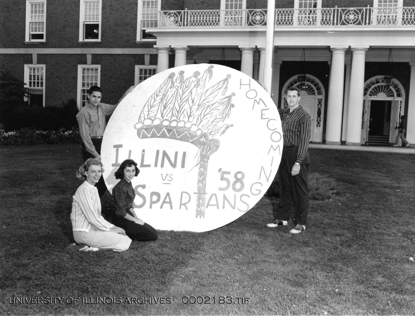 Students+stand+in+front+of+the+Illini+Union+with+a+Homecoming+decoration+in+1958.