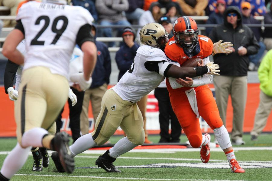 Illinois%E2%80%99+Reilly+O%E2%80%99Toole+is+tackled+after+scrambling+during+the+game+against+Purdue+on+Saturday.+O%E2%80%99Toole%2C+who+will+start+in+Saturday%E2%80%99s+game+against+Wisconsin%2C+has+been+the+backup+quarterback+for+Nathan+Scheelhaase+and+now+Wes+Lunt.