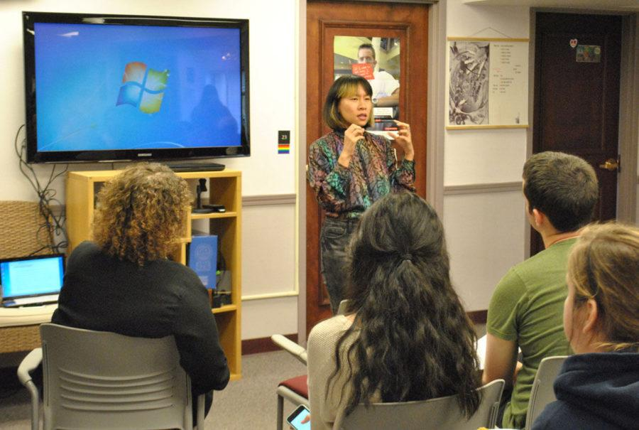 Speaker, Kelly Zen-Yie Tsai, describes the seminar to the students at Allen Hall on Monday.