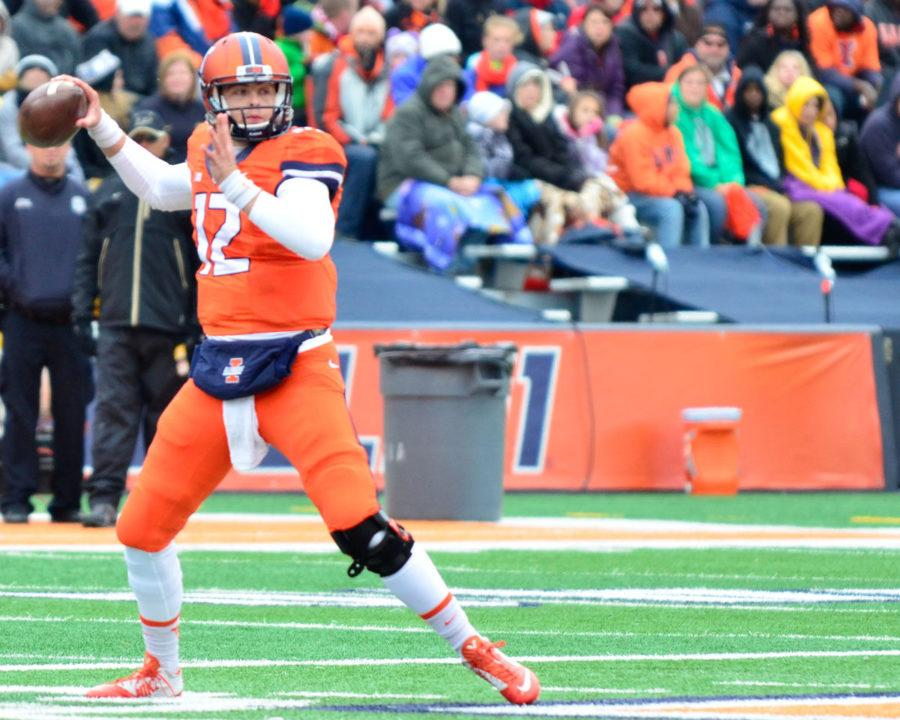 Illinois%27+Wes+Lunt+%2812%29+attempts+to+pass+the+ball+during+the+game+against+Purdue+at+Memorial+Stadium+on+Saturday%2C+Oct.+4%2C+2014.+The+Illini+lost+38-27.