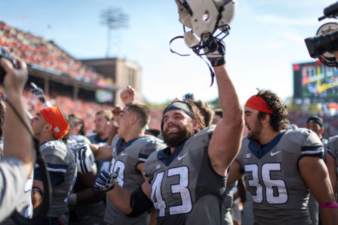 Illinois' Mason Monheim (43) raises his helmet after the homecoming game against Minnesota at Memorial Stadium on Saturday, Oct. 25, 2014. The Illini won 28-24.