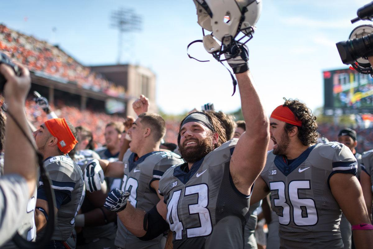 Illinois' Mason Monheim (43) raises his helmet after the homecoming game against Minnesota at Memorial Stadium on Saturday, Oct. 25, 2014. The Illini won 28-24.