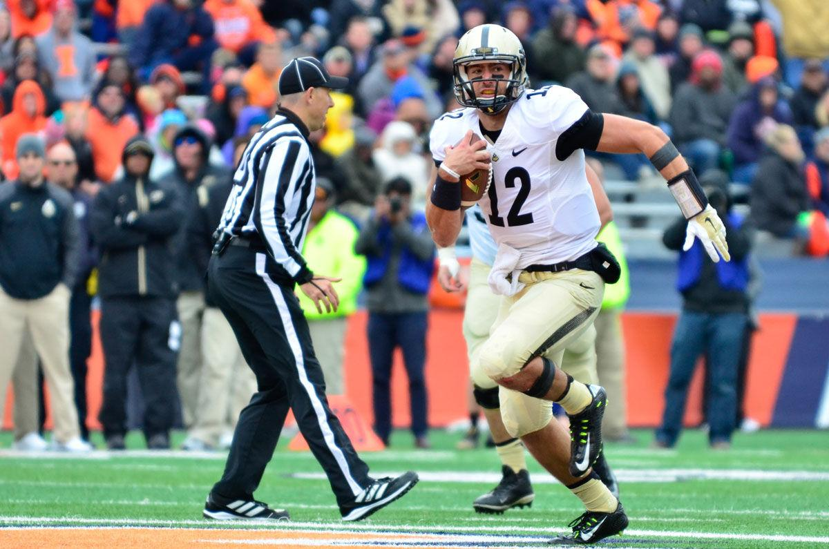 Purdue's Austin Appleby (12) runs the ball during the game at Memorial Stadium on Saturday, Oct. 4, 2014. The Illini lost 38-27.