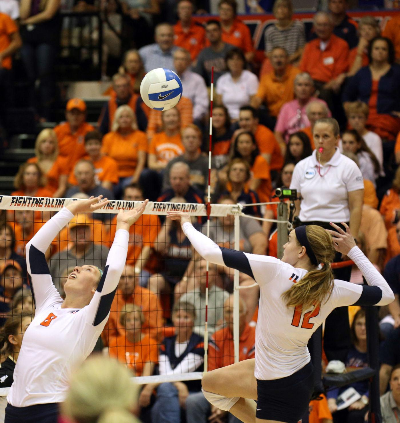 Illinois' Katie Stadick (12) rises for a spike during the winning game against Purdue last season.