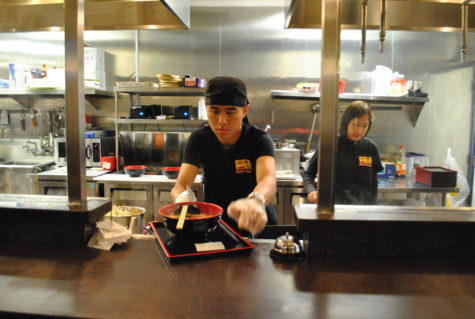 Koto Ramen employee, Calvin Law, serves a fresh bowl of ramen beside manager, Amy Chook.