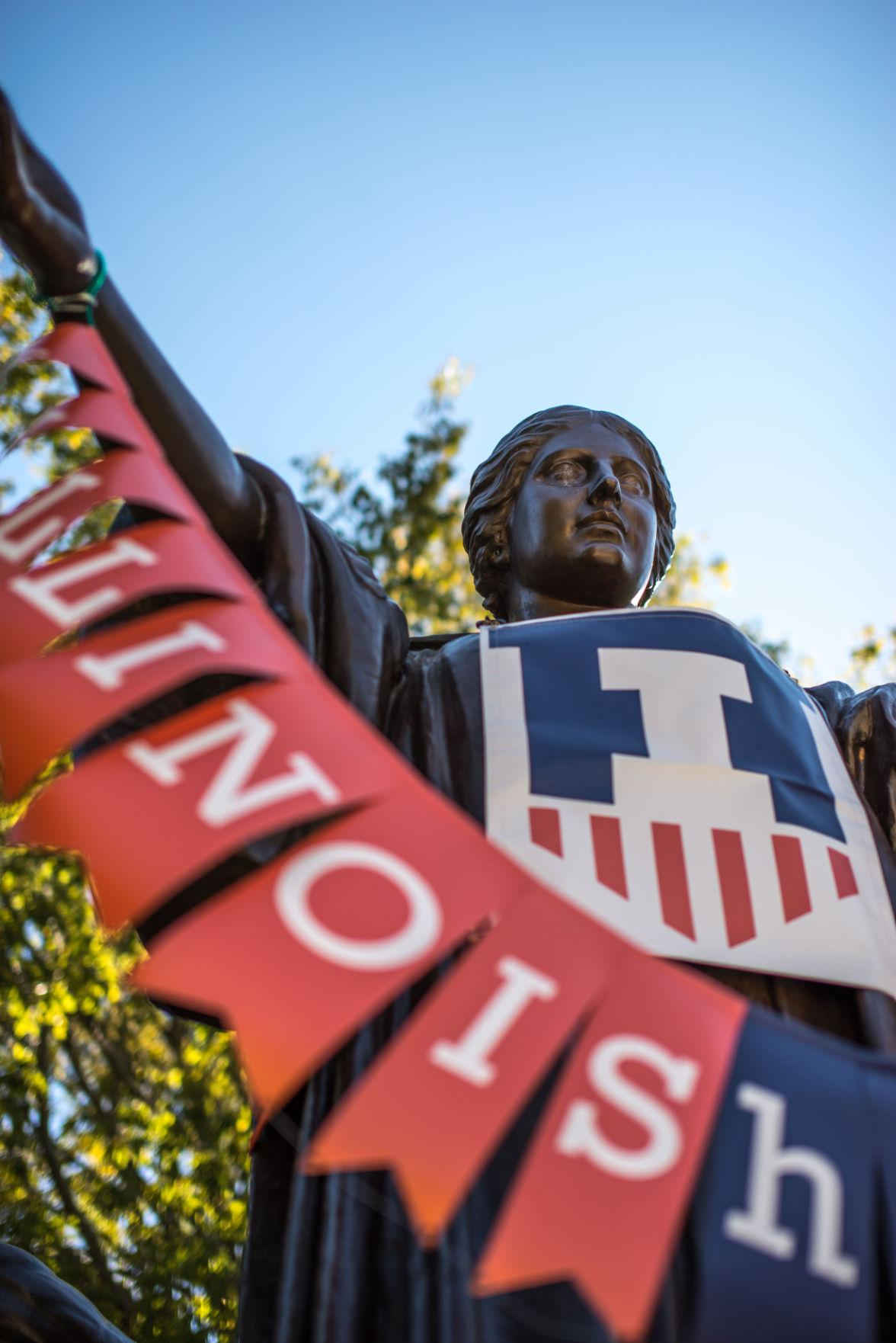 The Alma Mater statue, adorned with homecoming banner and regalia, has scratches on its right eye from vandalism that was first reported by a University employee on Friday.