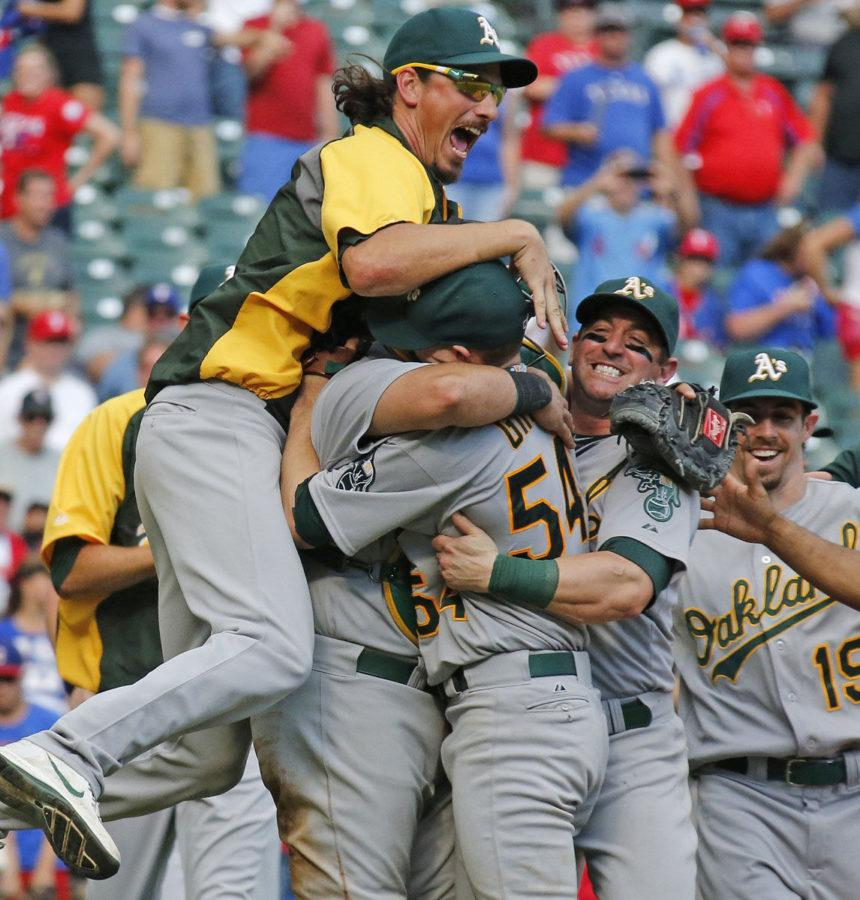 Oakland+Athletics+pitcher+Jeff+Samardzija%2C+left%2C+and+other+teammates+embrace+starting+pitcher+Sonny+Gray+after+the+final+out+in+their+wild+card-clinching+4-0+win+against+the+Texas+Rangers+on+Sunday+in+Arlington%2C+Texas.