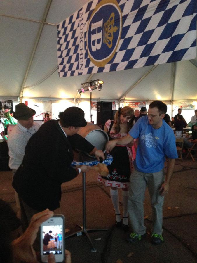 Attendees+and+performers+enjoy+the+inaugural+Champaign-Urbana+Oktoberfest+at+the+Big+Grove+Tavern+on+Oct.+12%2C+2013.