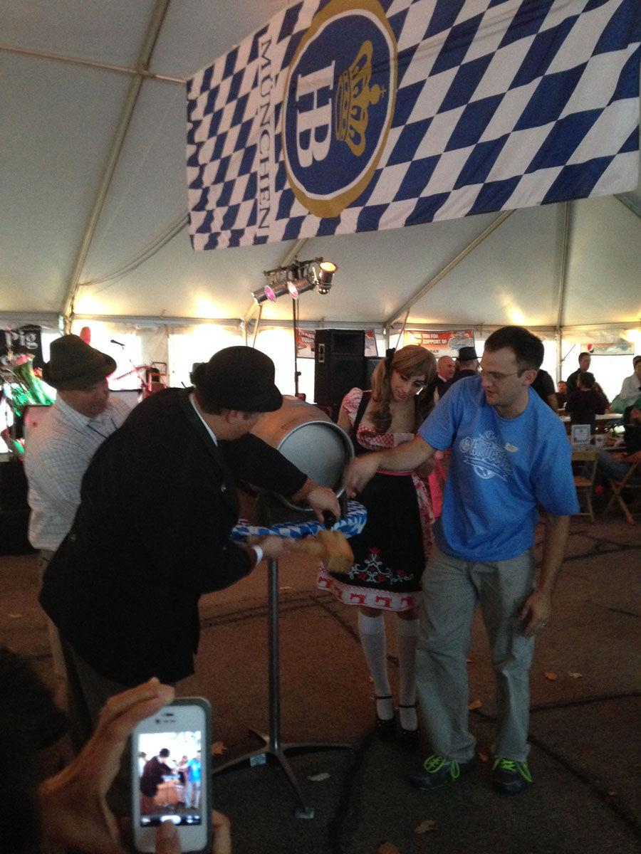 Attendees and performers enjoy the inaugural Champaign-Urbana Oktoberfest at the Big Grove Tavern on Oct. 12, 2013.