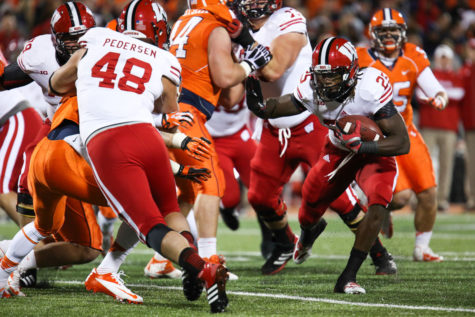 Wisconsin's Melvin Gordon runs with the ball during Illinois' game against No. 25 Wisconsin at Memorial Stadium, on Oct. 19, 2013.