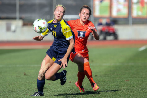 Illinois' Reagan Robishaw challenges for possession during the game against Michigan at Illinois Track and Soccer stadium on Sunday, Oct. 26. The Illini lost 2-1. Robishaw and her teammates look to prove themselves tomorrow against UW.