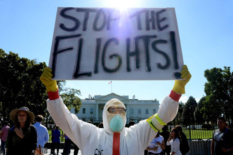 A protester stands outside the White House asking President Obama to ban flights in effort to stop Ebola, the deadly epidemic that has already reached American soil, on October 17, 2014 in Washington, D.C. The debate surrounding travel bans as a way to curb the spread of Ebola has intensified after Thursdays congressional hearing, unleashing a flurry of impassioned arguments on both sides. (Olivier Douliery/Abaca Press/MCT)
