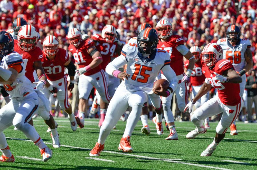 Illinois%27+Aaron+Bailey+%2815%29+runs+the+ball+for+a+touchdown+during+the+game+against+Wisconsin+at+Camp+Randall+Stadium+in+Madison%2C+Wis.+on+Oct.+11.+The+Illini+lost+38-28.