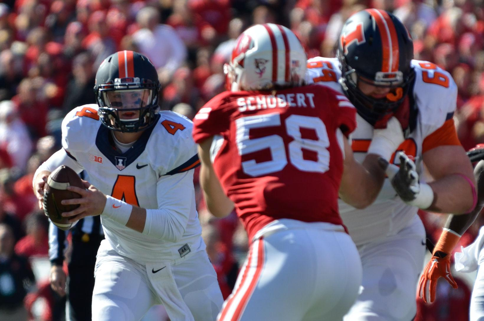Illinois' Reilly O'Toole runs the ball during the game against Wisconsin at Camp Randall Stadium in Madison, Wis. on Oct. 11. The Illini lost 38-28.