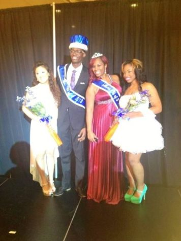 Past Mr. and Ms. U of I winners pose after being crowned.