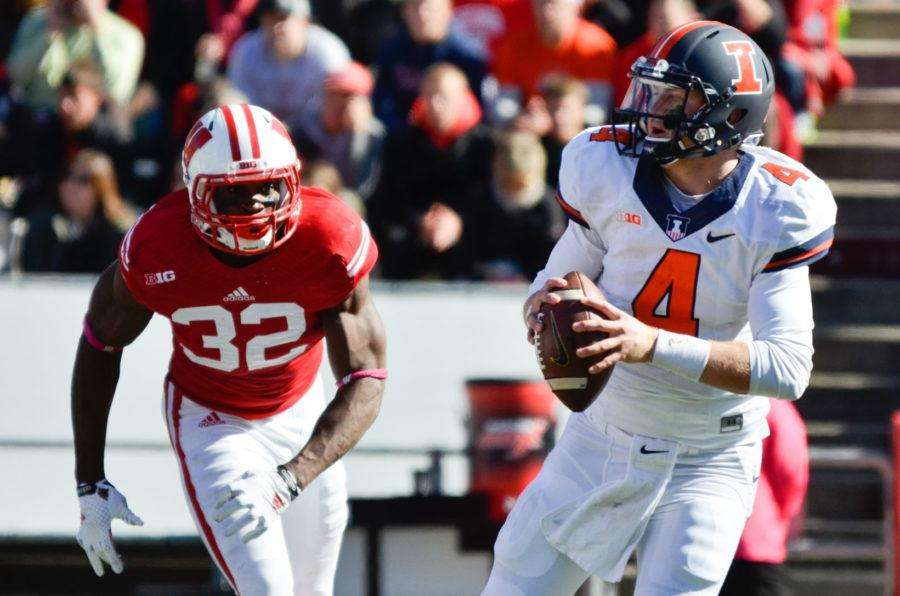 Illinois%27+Reilly+O%27Toole+%284%29+attempts+to+pass+the+ball+during+the+game+against+Wisconsin+at+Camp+Randall+Stadium+in+Madison%2C+Wis.+on+Saturday%2C+Oct.+11%2C+2014.+The+Illini+lost+38-28.