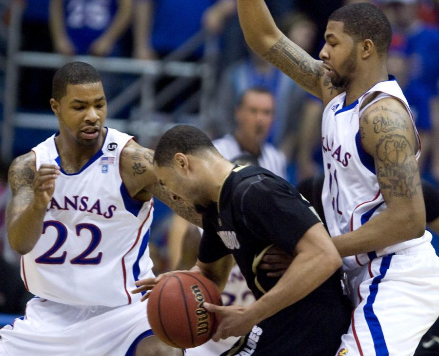 Kansas defender Marcus Morris (22) and Markieff Morris, right, sandwich Colorado's Marcus Relphorde as he tried to drive to the basket during the first half at Allen Fieldhouse in Lawrence, Kansas, Saturday, February 19, 2011. Kansas defeated Colorado, 89-63. (Rich Sugg/Kansas City Star/MCT)