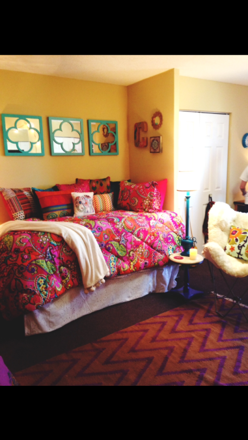 A fun rug, soft blanket and colorful throw pillows add a cozy and unique personality to this Bromley Hall dorm room. There are easy ways to make your space feel like home.