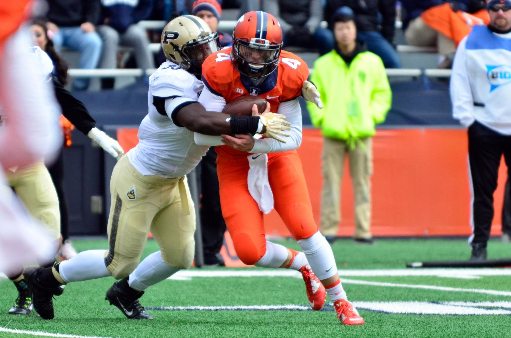 Illinois' Reilly O'Toole is sacked by Purdue's Ja'Whaun Bentley on Oct. 4. O'Toole came in to his freshman year as the backup quarterback for Nathan Scheelhaase. Entering this season as a senior, he was slated as the backup to transfer Wes Lunt.