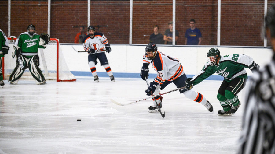 Illinois%E2%80%99+John+Olen+and+Michigan+Sate%E2%80%99s+Michael+Ferrantino+clash+sticks+as+they+fight+for+control+over+the+puck+at+the+Illinois+Ice+Arena+on+Sept.+27.%C2%A0