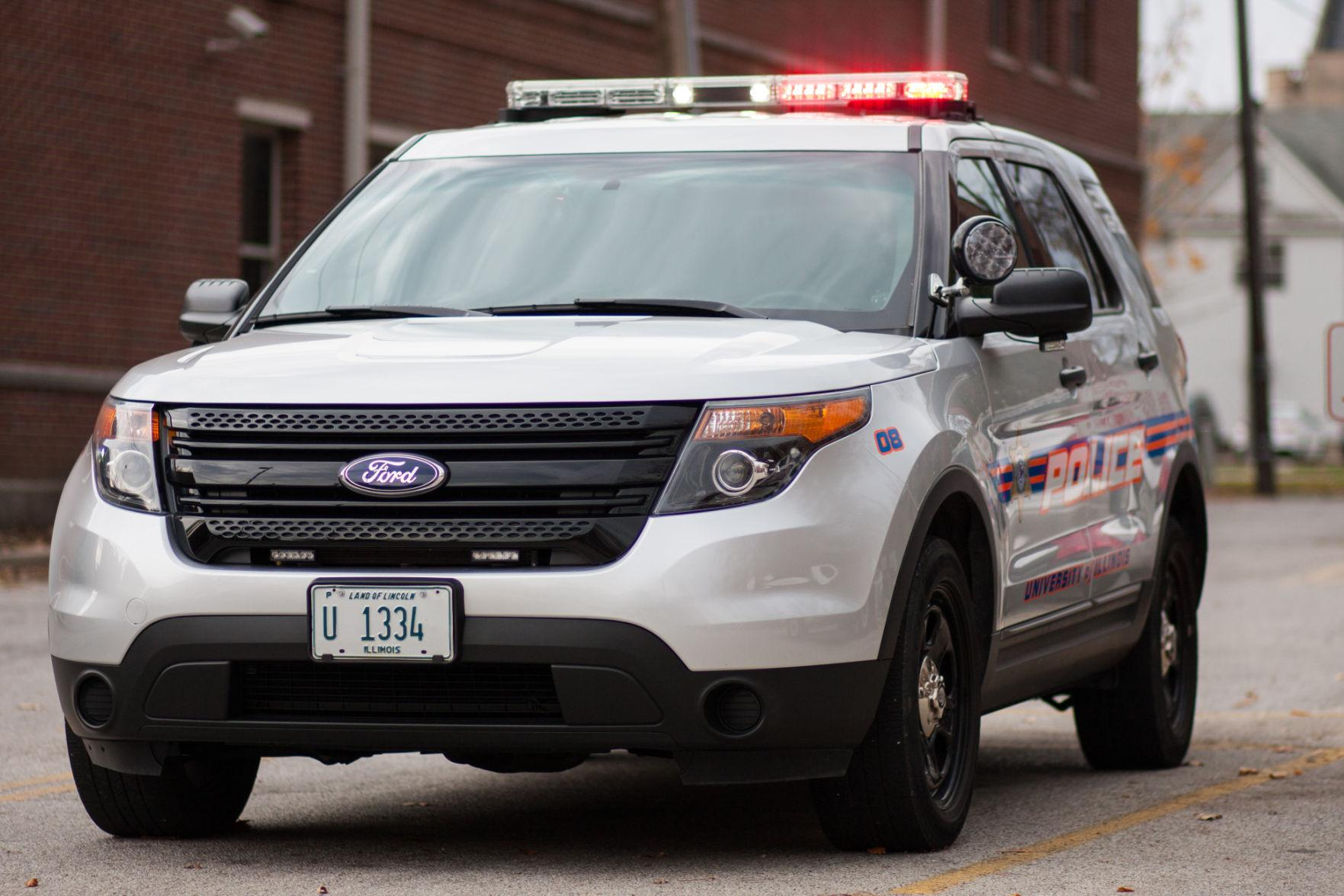 A UIPD police car sits in the parking lot at the Division of Public Safety building on Monday.