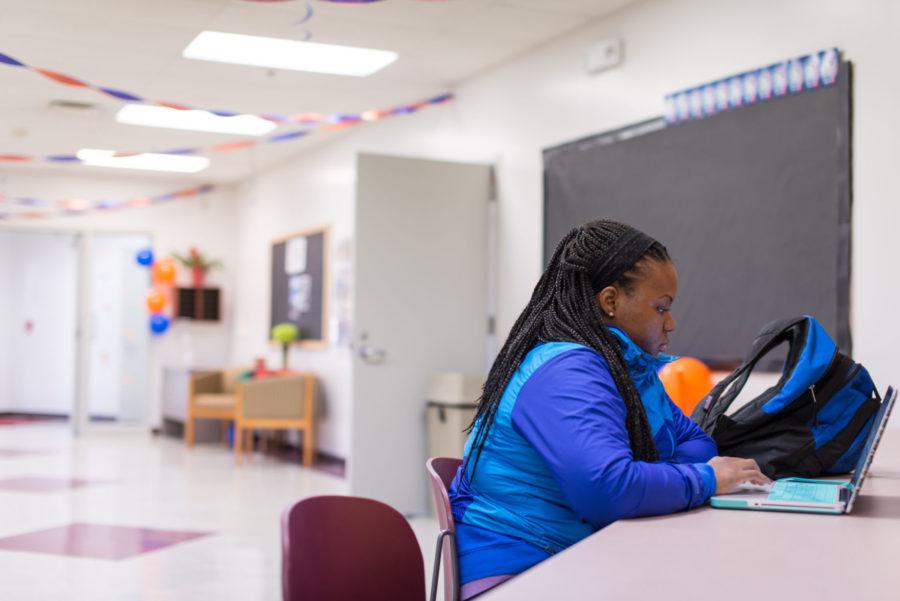 Ashley+Ojiemwen%2C+senior+of+AHS%2C+studying+at+Bruce+D.+Nesbitt+African+American+Cultural+Center+on+Oct.+22%2C+2014.