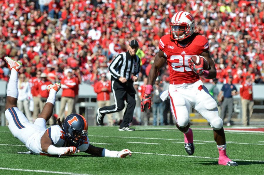 Wisconsin's Melvin Gordon (25) runs the ball during the game at Camp Randall Stadium in Madison, Wis. on Saturday, Oct. 11, 2014. The Illini lost 38-28.
