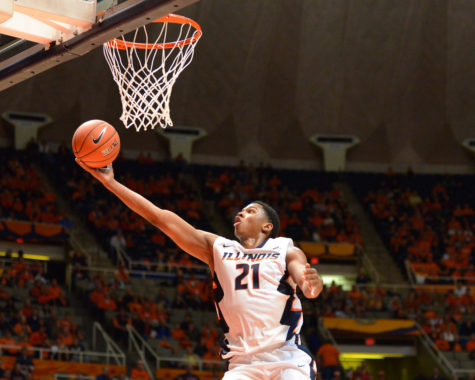 Illinois' Malcolm Hill (21) does a layup during the exhibition game against Quincy at State Farm Center on Friday. The Illini won 91-62 and Hill led the team with 20 points.