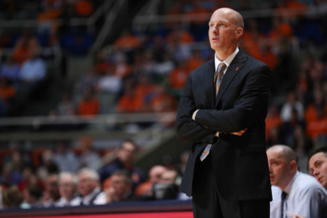 Illinois' head coach John Groce looks towards the score board during the game against Brown at State Farm Center, on Nov. 24, 2014. The Illini won 89-68.