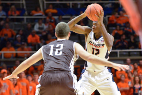 Illinois' Leron Black looks for an open pass during the exhibition game against Quincy at State Farm Center on Friday. The Illini won 91-62. Black scored 15 points and grabbed eight rebounds.