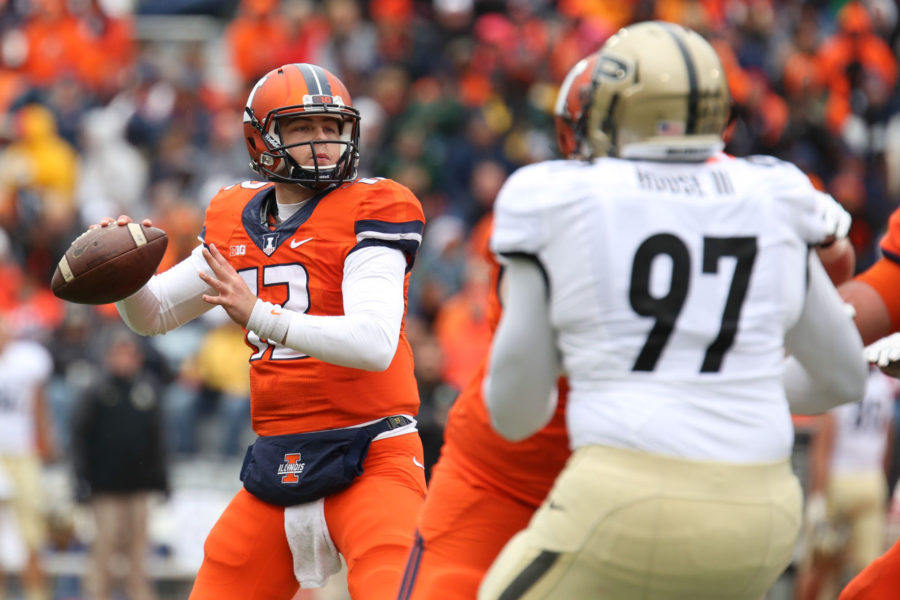 Illinois%27+Wes+Lunt+%2812%29+attempts+a+pass+during+the+game+against+Purdue+at+Memorial+Stadium+on+Saturday+Oct.+4.