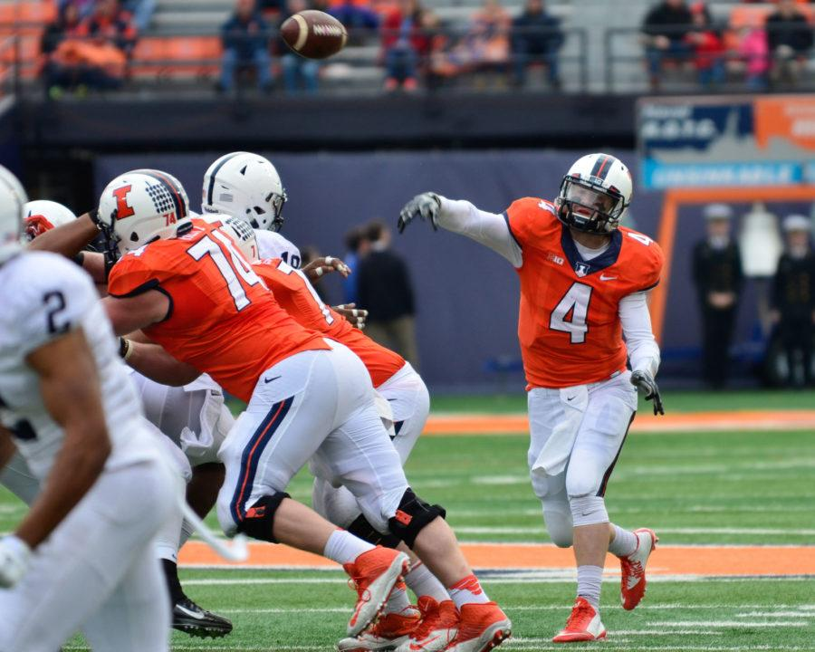 Illinois%27+Reilly+O%27Toole+%284%29+passes+the+balll+during+the+game+against+Penn+State+at+Memorial+Stadium+on+Saturday%2C+Nov.+22%2C+2014.+The+Illini+won+16-14.