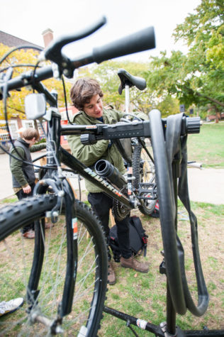 Thane Fowler, Sophomore in General Studies, president of BikeFace fixes bicycles on the main quad to raise fund for making human power nut grinder on Oct. 23, 2013