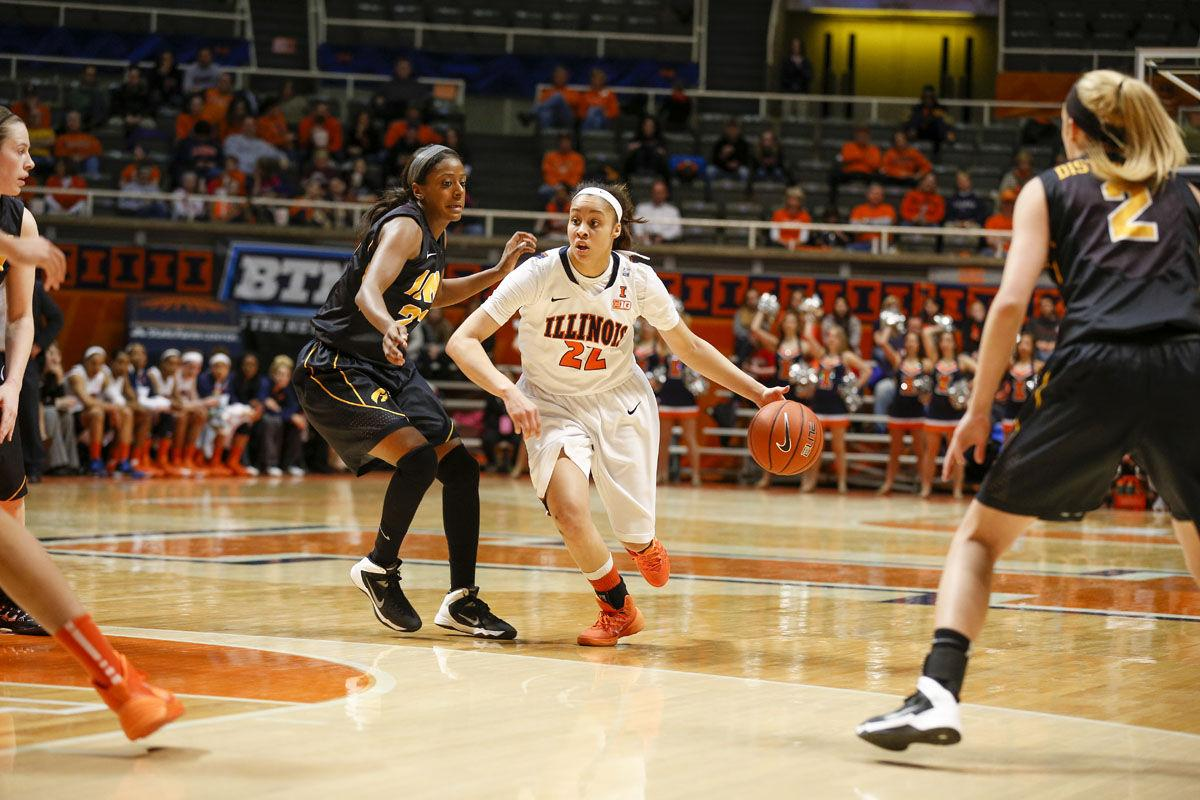 Illinois' Ivory Crawford (22) drives the ball during the game against Iowa at State Farm Center on Sunday, March 2, 2014.