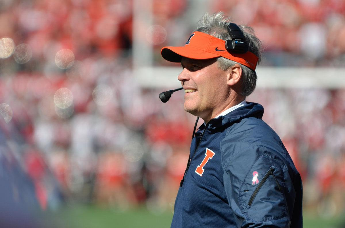 Illinois' head coach Tim Beckman smiles after a touchdown during the game against Wisconsin at Camp Randall Stadium in Madison, Wis. on Saturday, Oct. 11, 2014. The Illini lost 38-28.