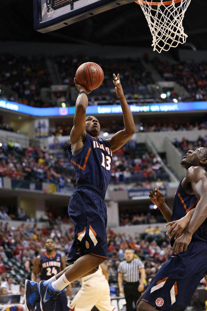 Illinois' Tracy Abrams (13) attempts a layup during the first round game of the Big Ten Men's Basketball Tournament against Indiana at Banker's Life Fieldhouse, on Thursday, Mar. 13, 2014 The Illini won 64-54.