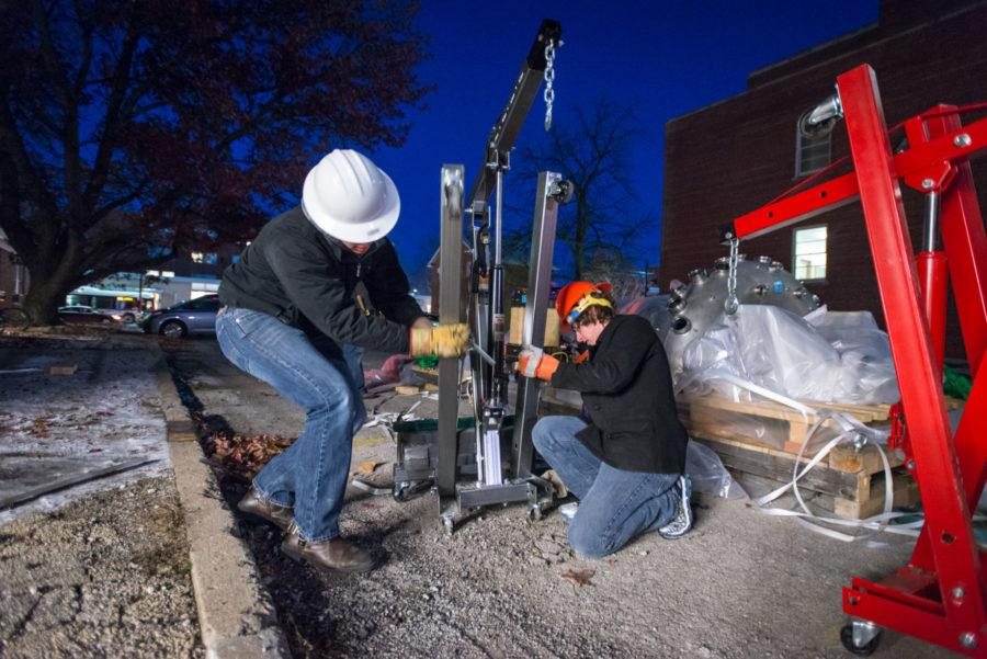 Students utilize cranes and other devices to move parts of the Hybrid Illinois Device for Research and Applications into the Nuclear Radiation Laboratory on Monday, November 17.