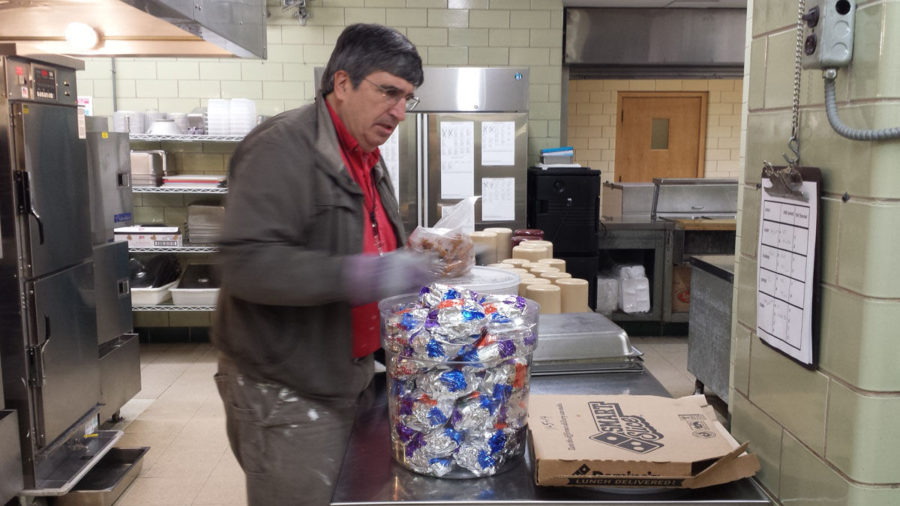 Cliff Maduzia packages excess food from Unit 4's Central High School's lunches to bring to the TIMES Center. Maduzia is a volunteer for the Susan Freiburg Memorial Food Surplus program, which provides meals to the homeless.