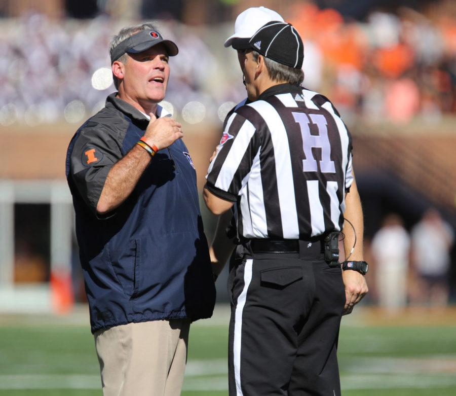 Illinois' head coach Tim Beckman speaks to the officials during the homecoming game against Minnesota at Memorial Stadium on Oct. 25. The Illini must win their final two games to make a bowl game.
