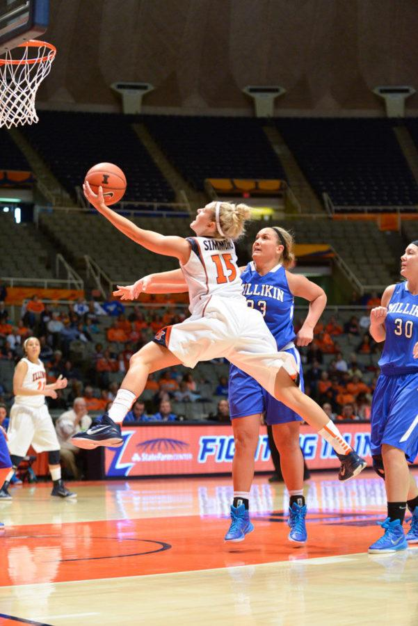 Illinois' Kyley Simmons (15) lays the ball up during the exhibition game against Millikin at State Farm Center on Saturday. The Illini won 108-38.