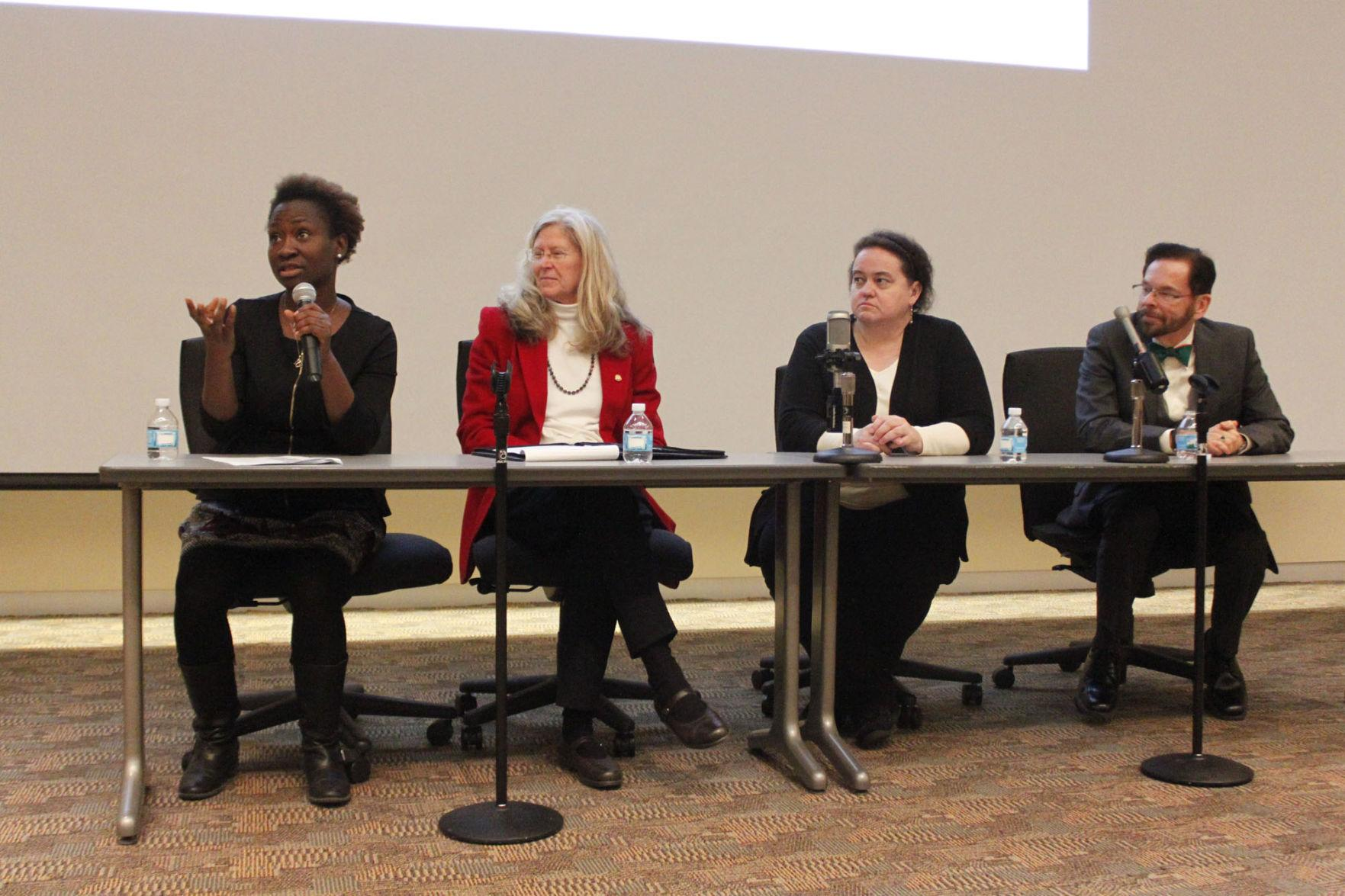 University alumnus Mabinty Tarawille speaks during the Ebola 101 Teach-In on Monday.