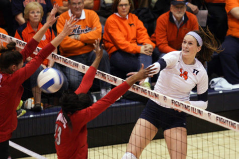 Illinois' Liz McMahon spikes the ball against Ohio State during Wednesday's five-set victory at Huff Hall.