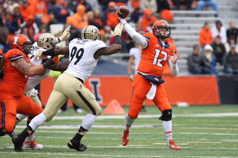 Illinois%27+Wes+Lunt+attempts+a+pass+during+the+game+against+Purdue+at+Memorial+Stadium+on+Saturday+Oct.+4.