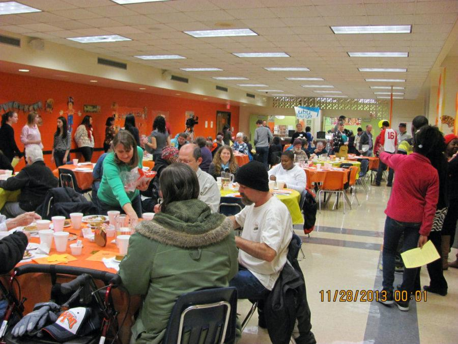 Champaign-Urbana citizens gather in the Urbana High School's cafeteria during the 2013 Annual Thanksgiving Dinner.