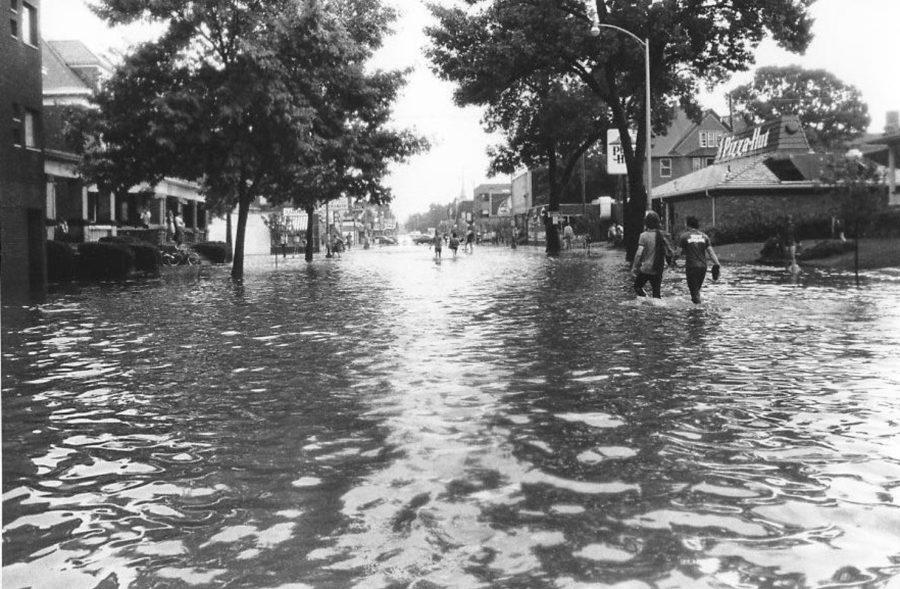 1980s: The waters of Boneyard Creek, which ran behind Green Street businesses, frequently spilled over and flooded storefronts located on the ground floor.