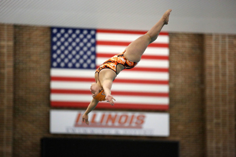 Illinois Emily Fung dives from the 3 meter board during the Orange and Blue Exhibition meet on Oct. 3. The diving team, which has three first-place finishes on the year, has provided the swimmers extra energy when they need it the most.