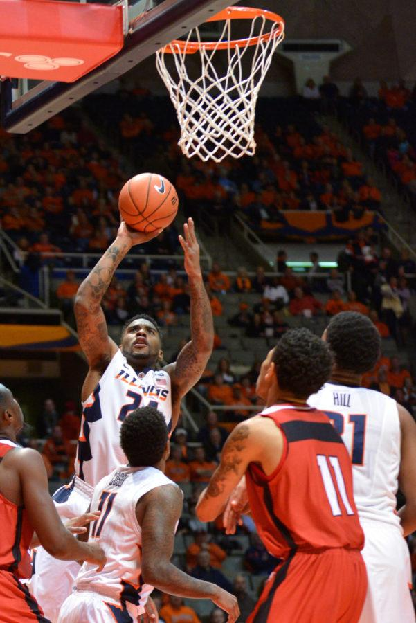 Illinois' Rayvonte Rice (24) lays the ball up during the game against Austin Peay at State Farm Center on Friday, Nov. 21, 2014. The Illini won 107-66.