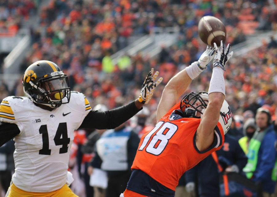 Illinois' Mike Dudek (18) reaches for a touchdown catch during the game against Iowa at Memorial Stadium, on Saturday, Nov. 15, 2014. The Illini lost 30-14.
